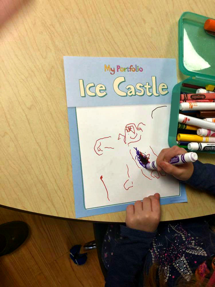 preschooler drawing portfolio page for ice and snow theme