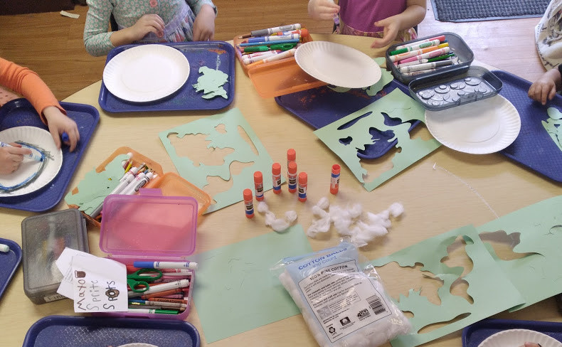 group of preschoolers making earth collage art