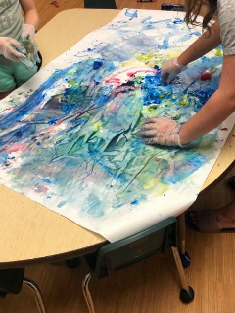 preschooler's ice painting artwork