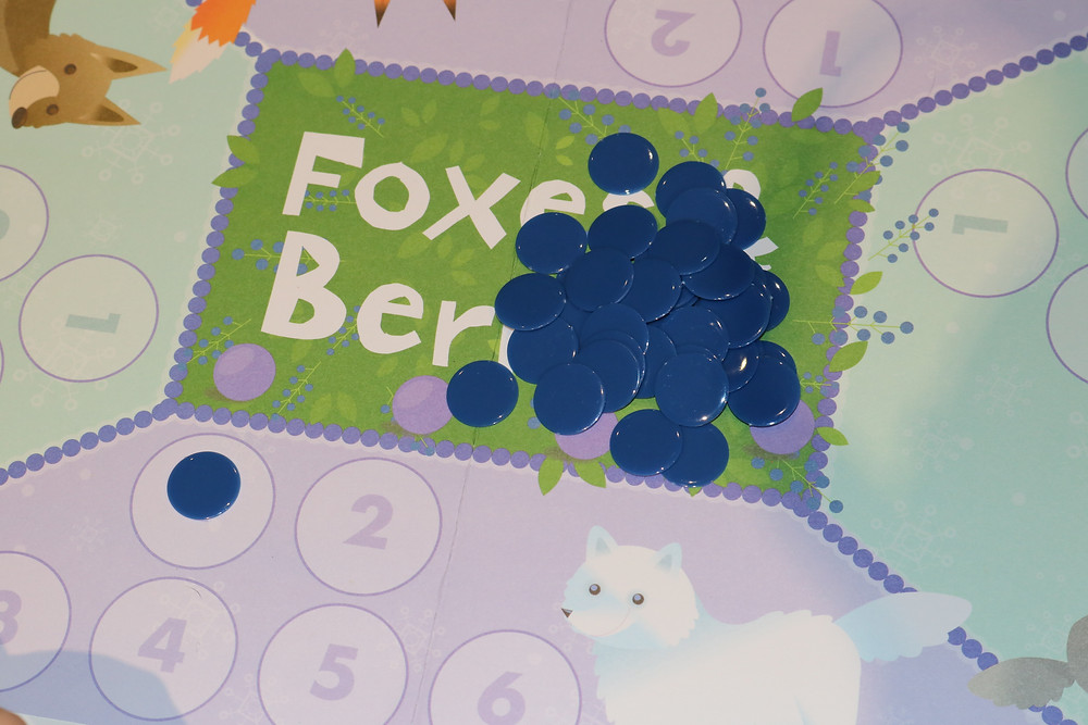 Fox & Berries gameboard with game pieces stacked in the center
