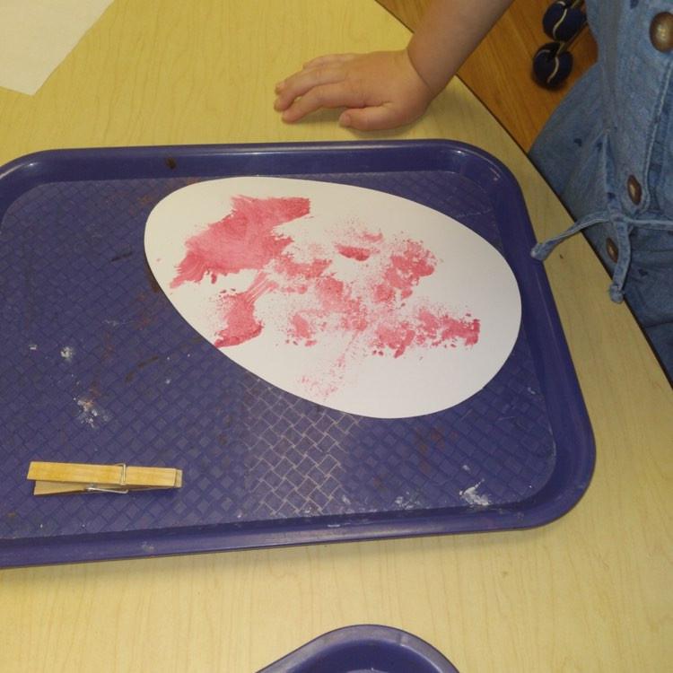 preschooler working on egg painting craft