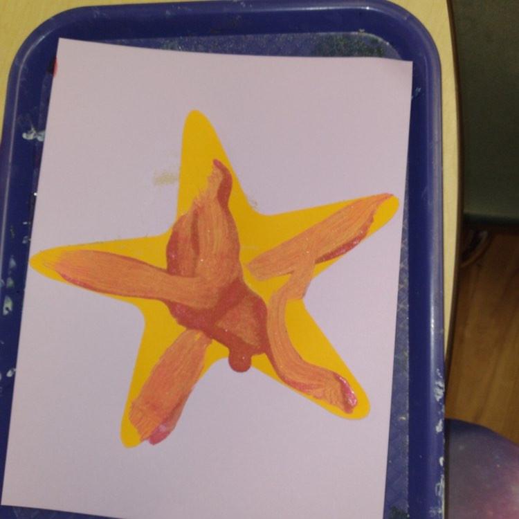 preschooler's painted starfish craft on tray