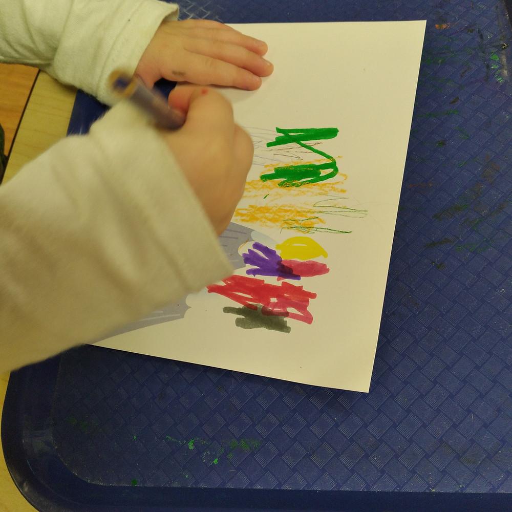 preschooler coloring on postcard