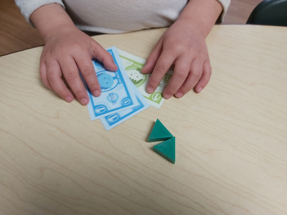 child counting pretend money