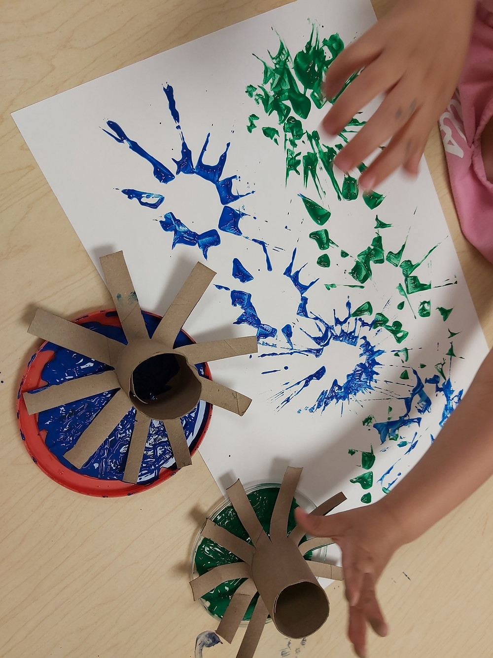 preschool using cardboard tubes to make fireworks