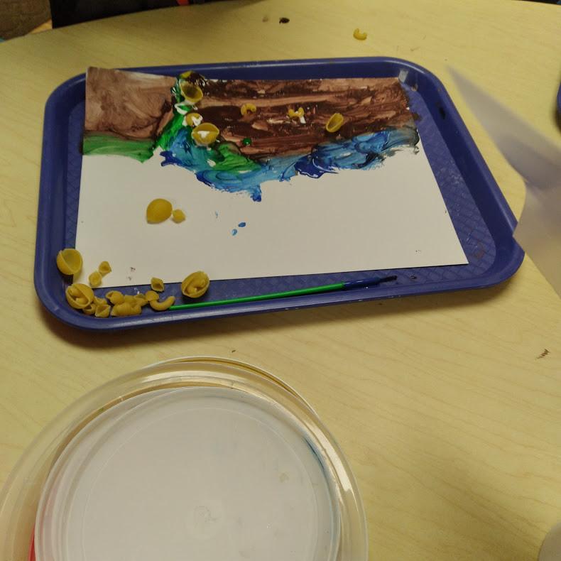 preschooler's noodle artwork on tray