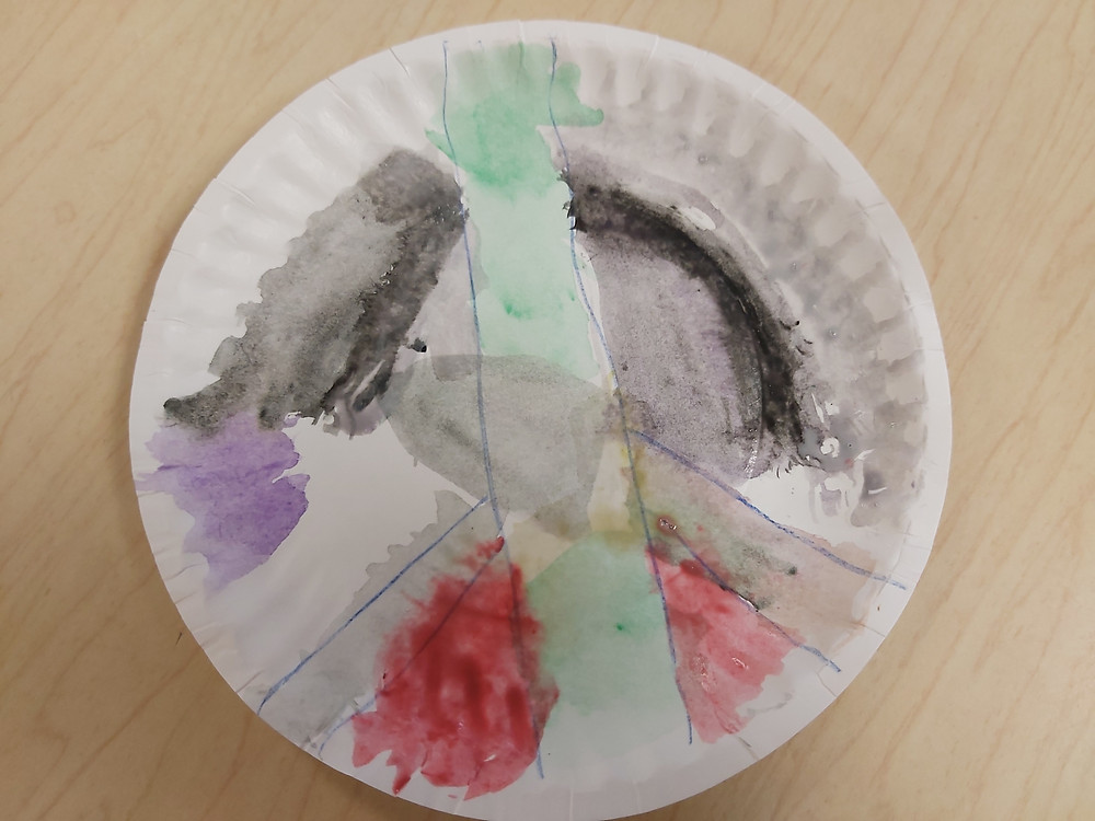 peace sign art on paper plate
