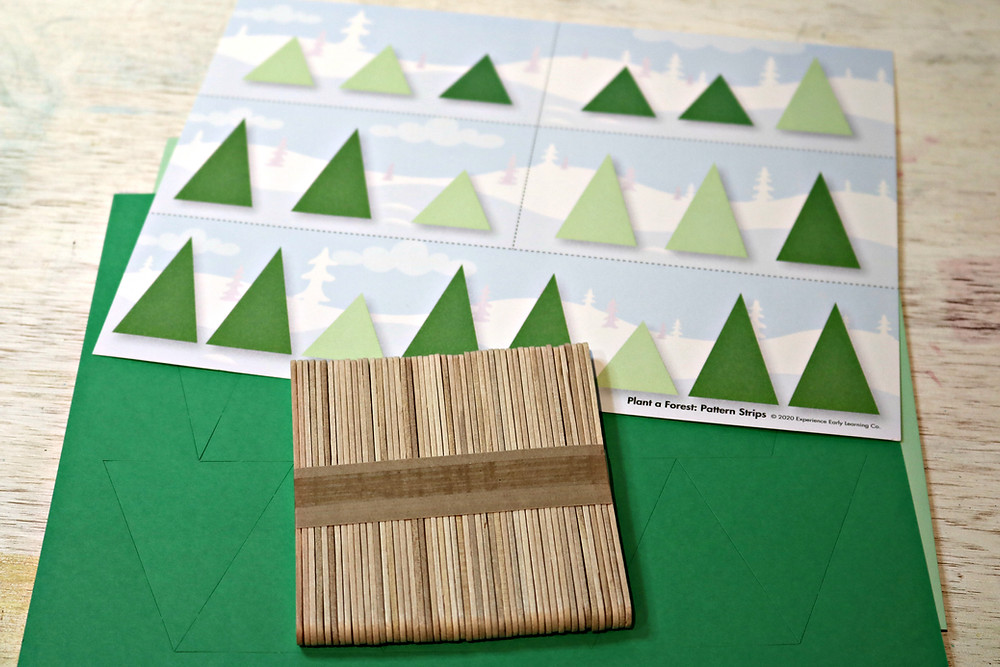 pattern strips with cardstock triangles and craft sticks to make tree patterns activity