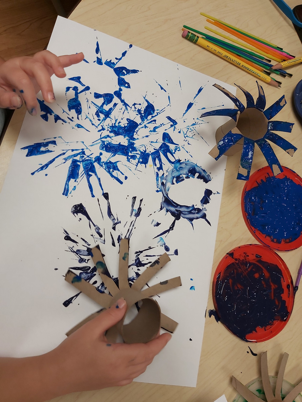 preschooler stamping fireworks using paint