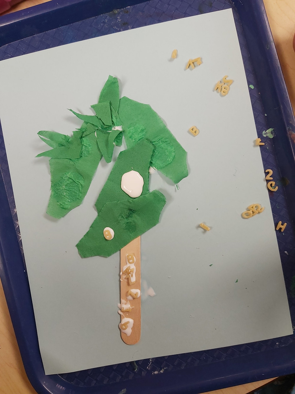 preschool coconut tree craft made from paper and alphabet pasta