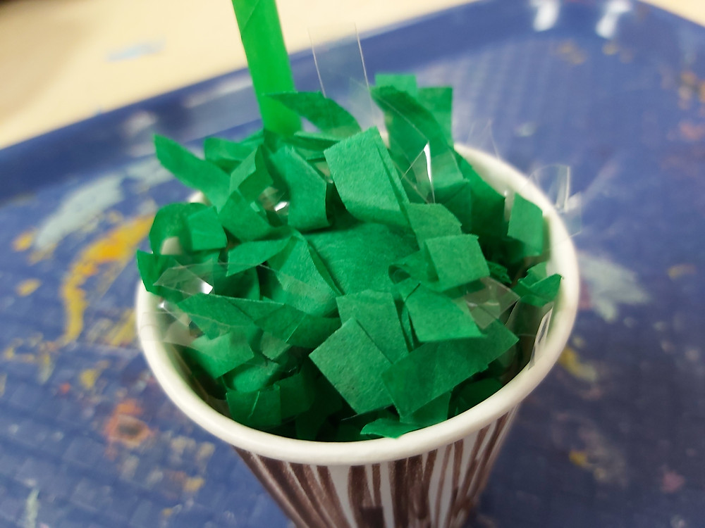 green festoon in paper cup