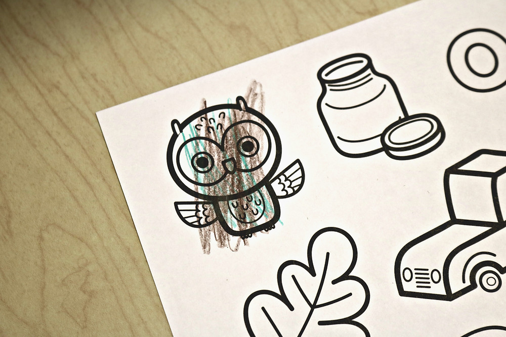 child's colored owl on O coloring page