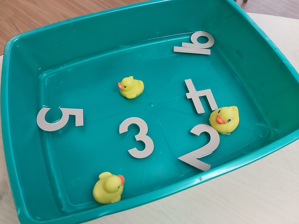 foam numbers in bin of water