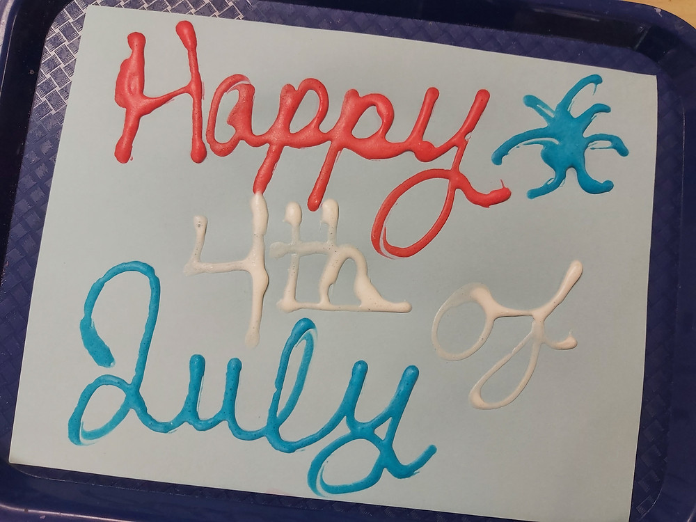 Happy 4th of July written in puffy paint on cardstock