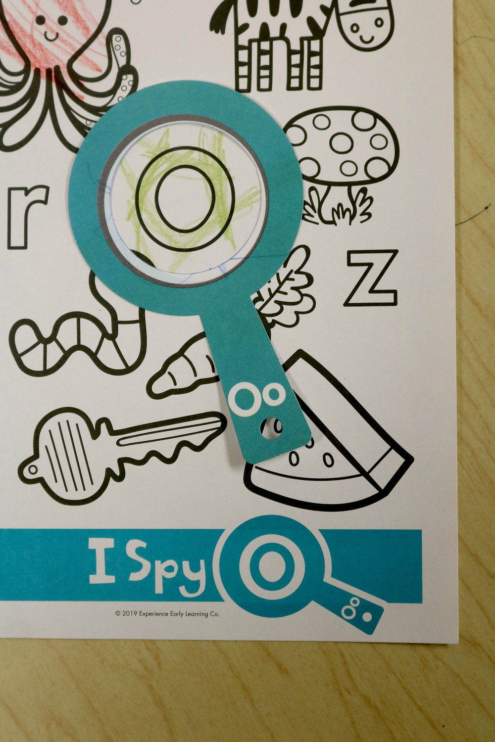 letter O coloring page with paper magnifying glass over the letter O