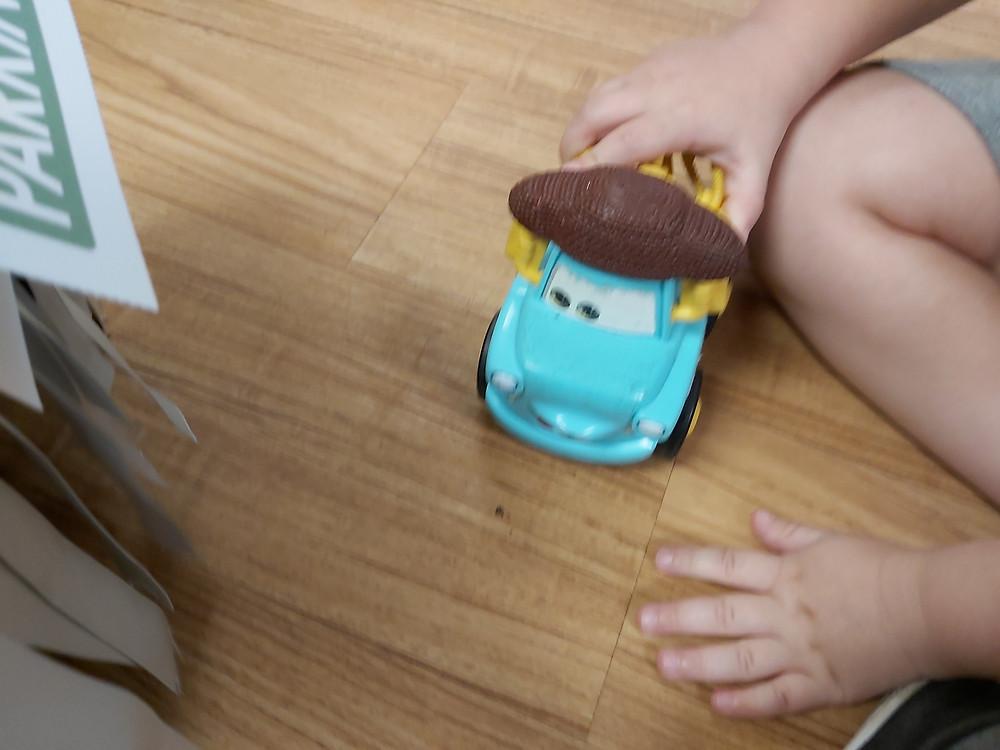 preschooler pushing car on floor