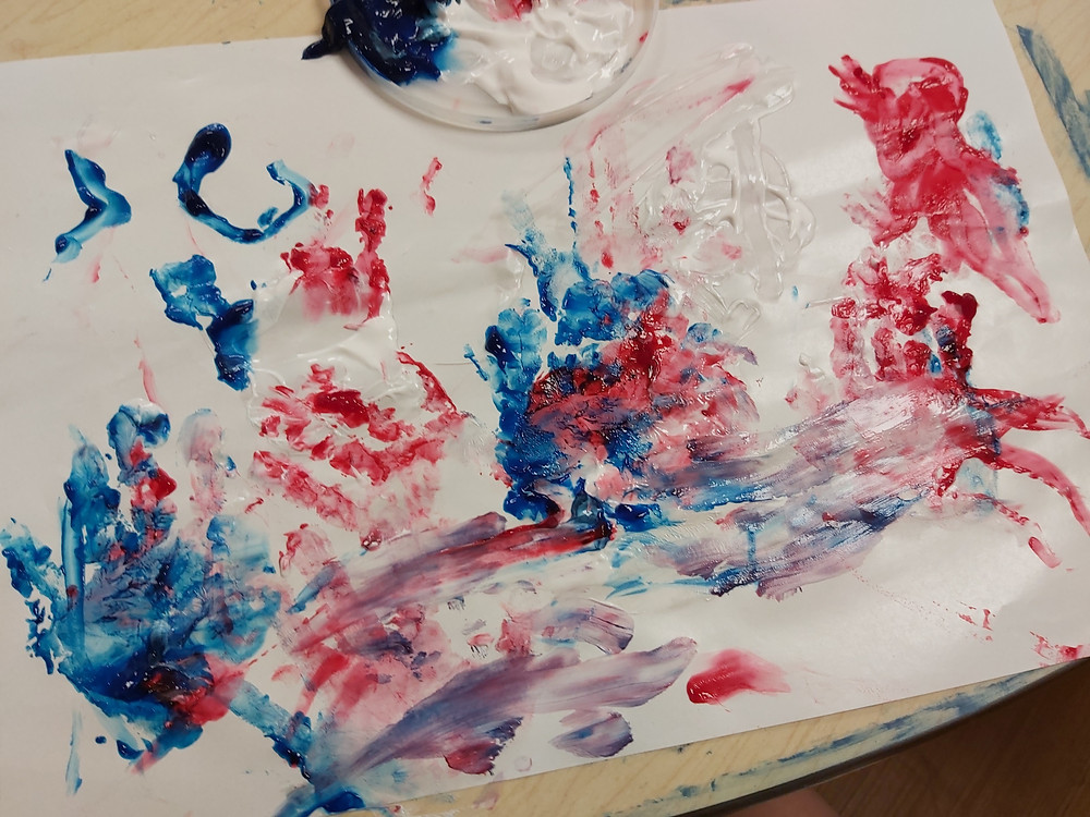 preschooler's red, white and blue fingerpaint
