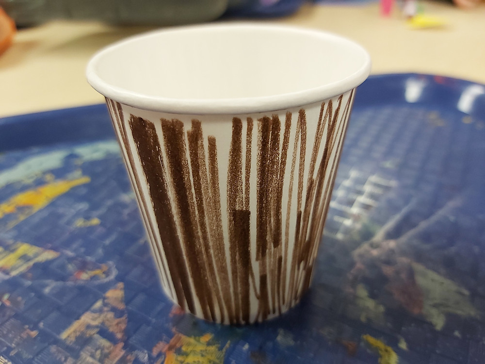 paper cup decorated to look like flowerpot