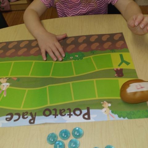 preschool playing potato race game