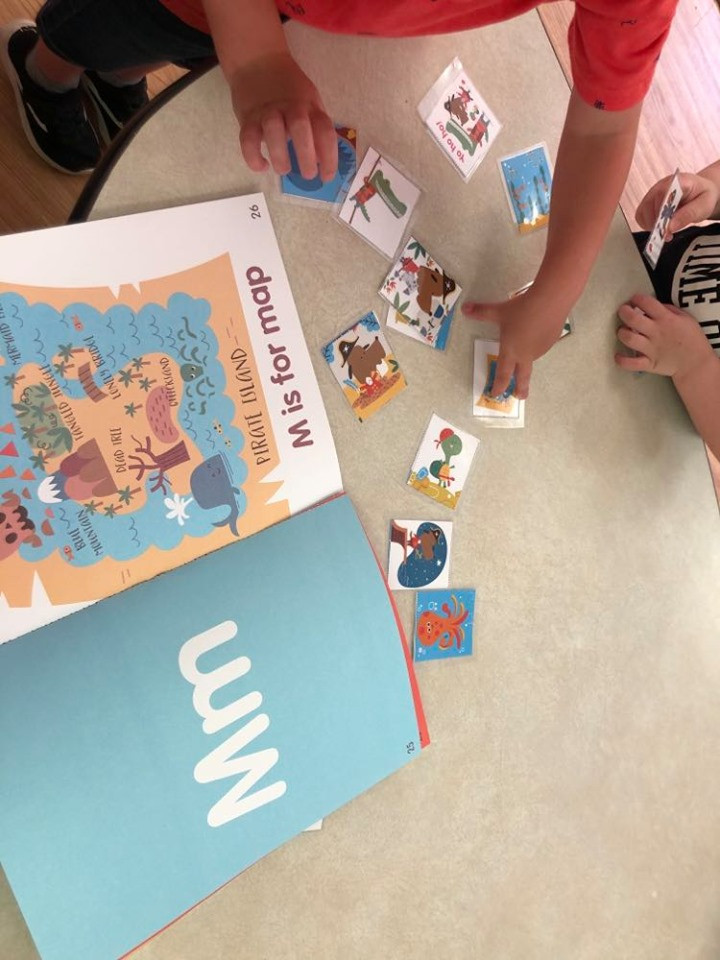 preschoolers playing matching game with picture cards