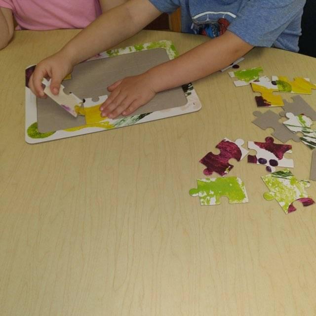 children putting together gardening puzzle