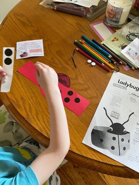 preschooler making ladybug headband craft