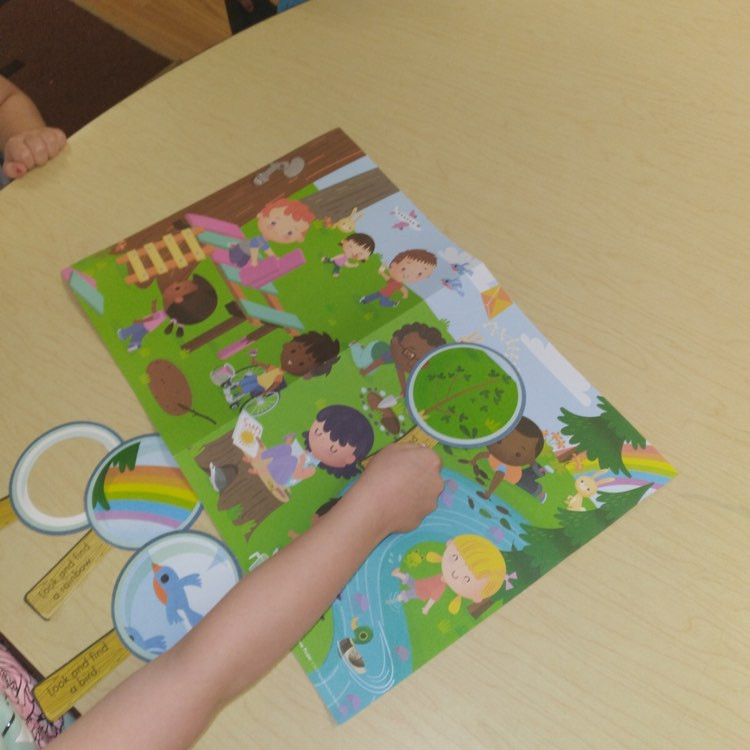 preschoolers exploring nature poster with paper magnifying glasses