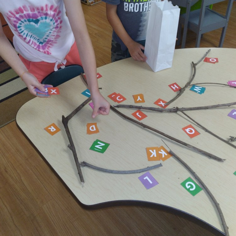 children matching letters using letter cards