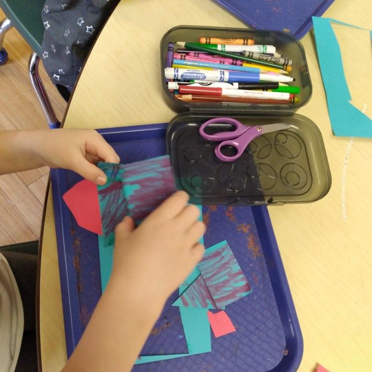 preschooler coloring paper rocket ship with markers
