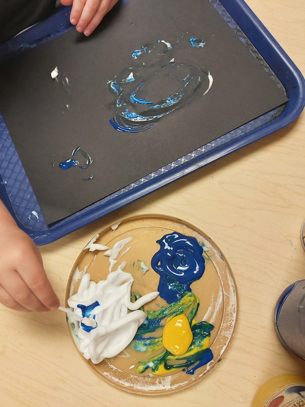 preschooler making hurricane art