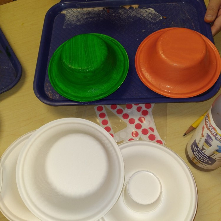painted cardboard bowls on tray