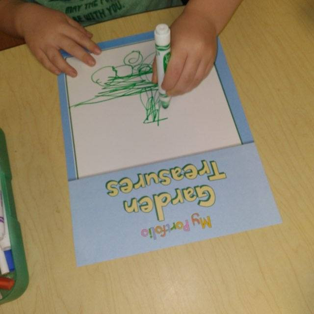 child coloring on portfolio cover page