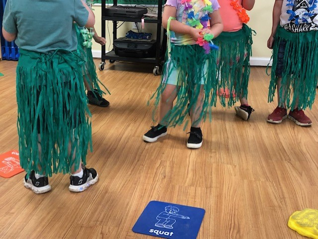 preschoolers wearing grass skirts
