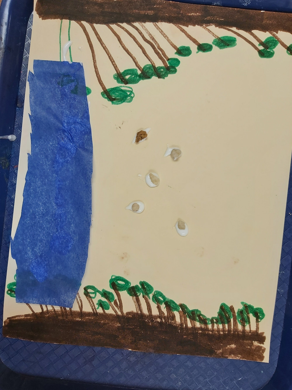 preschooler's rover collage with blue tissue paper