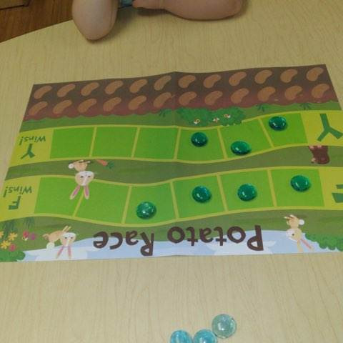potato race game board with several game pieces on it