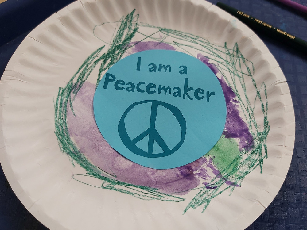 preschooler's Peacemaker process art on paper plate