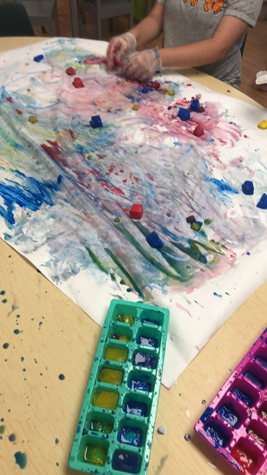 preschoolers painting with colored ice