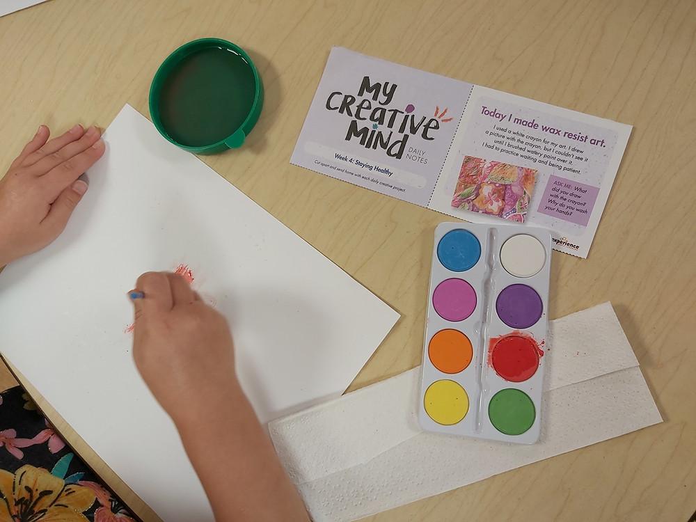 preschooler painting with watercolors