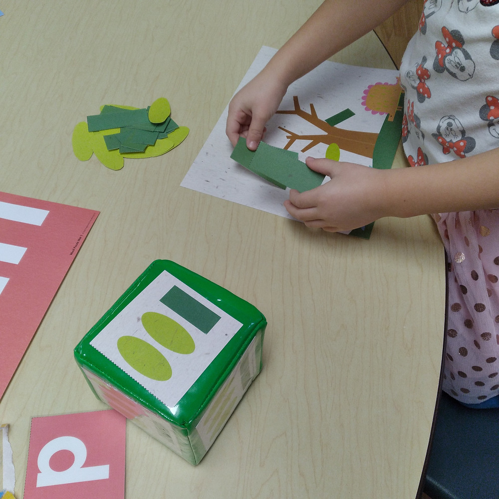 child putting shape game pieces onto gameboard