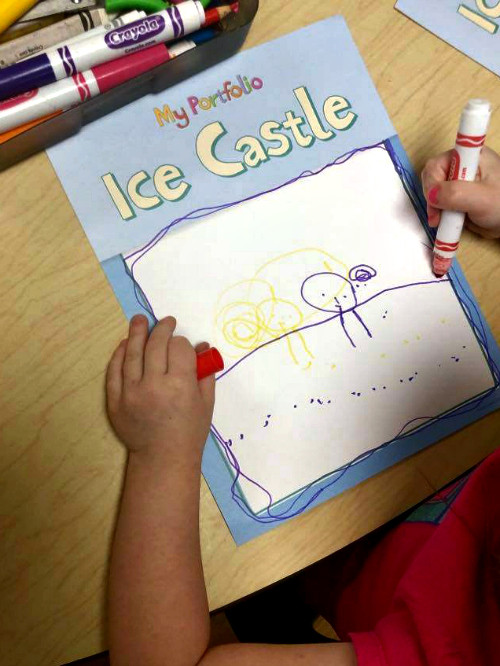 preschooler coloring on portfolio page using markers