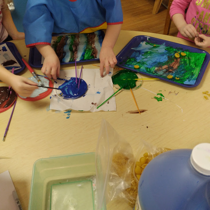 preschooler's working side by side making art with noodles