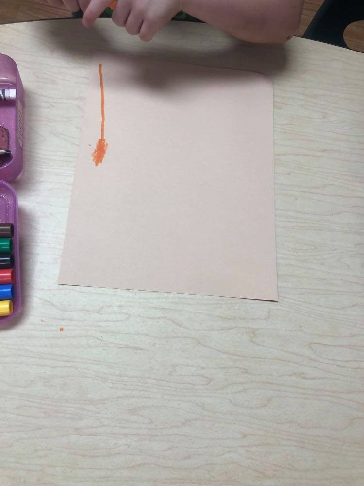 child drawing ostrich on background paper