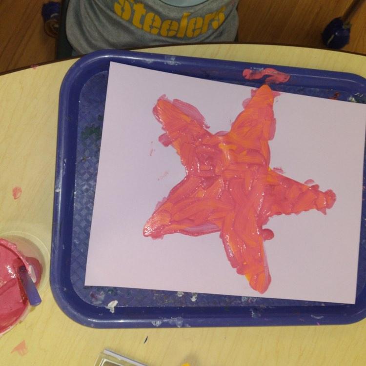 preschooler's bumpy star fish craft on tray