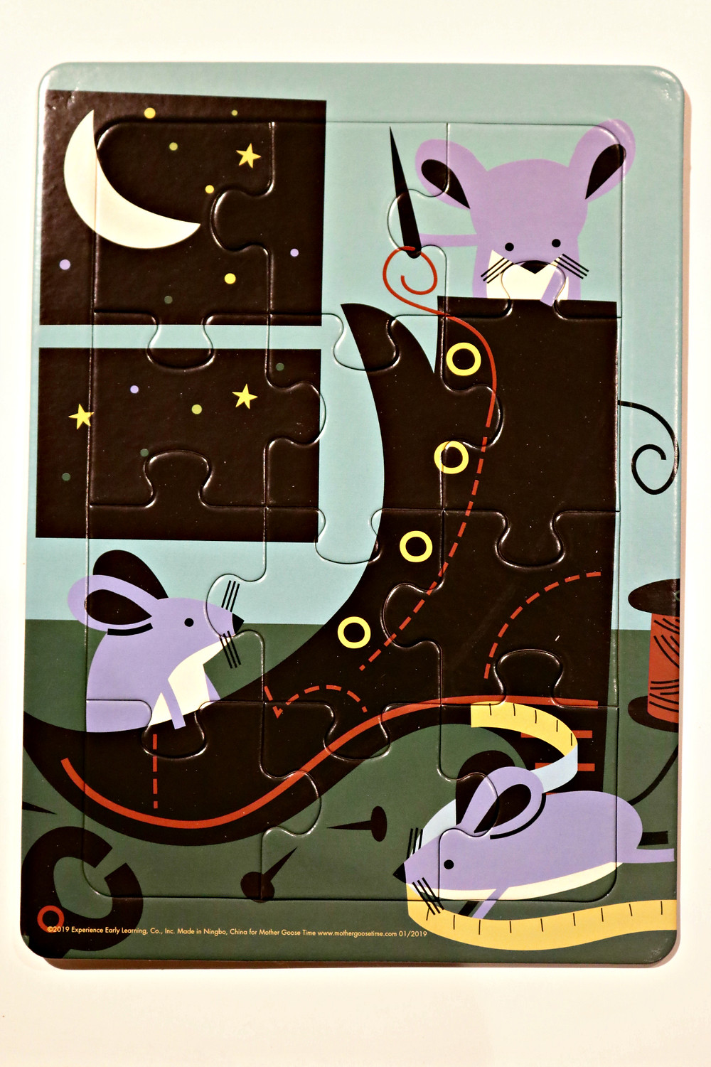 puzzle featuring mice sewing boot