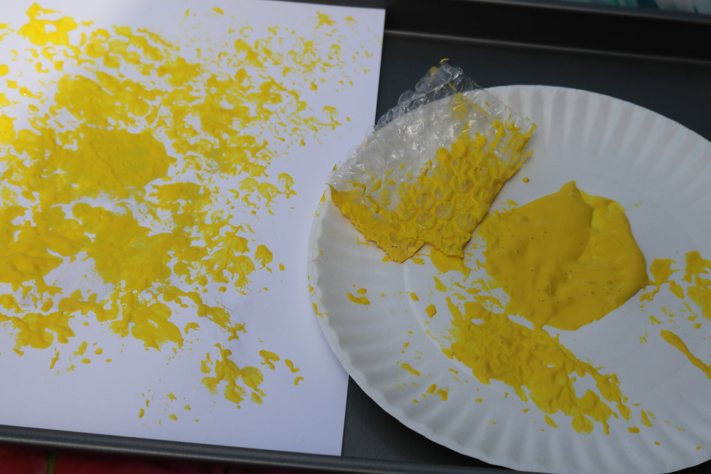 beehive painting with bubble wrap and yellow paint on white cardstock