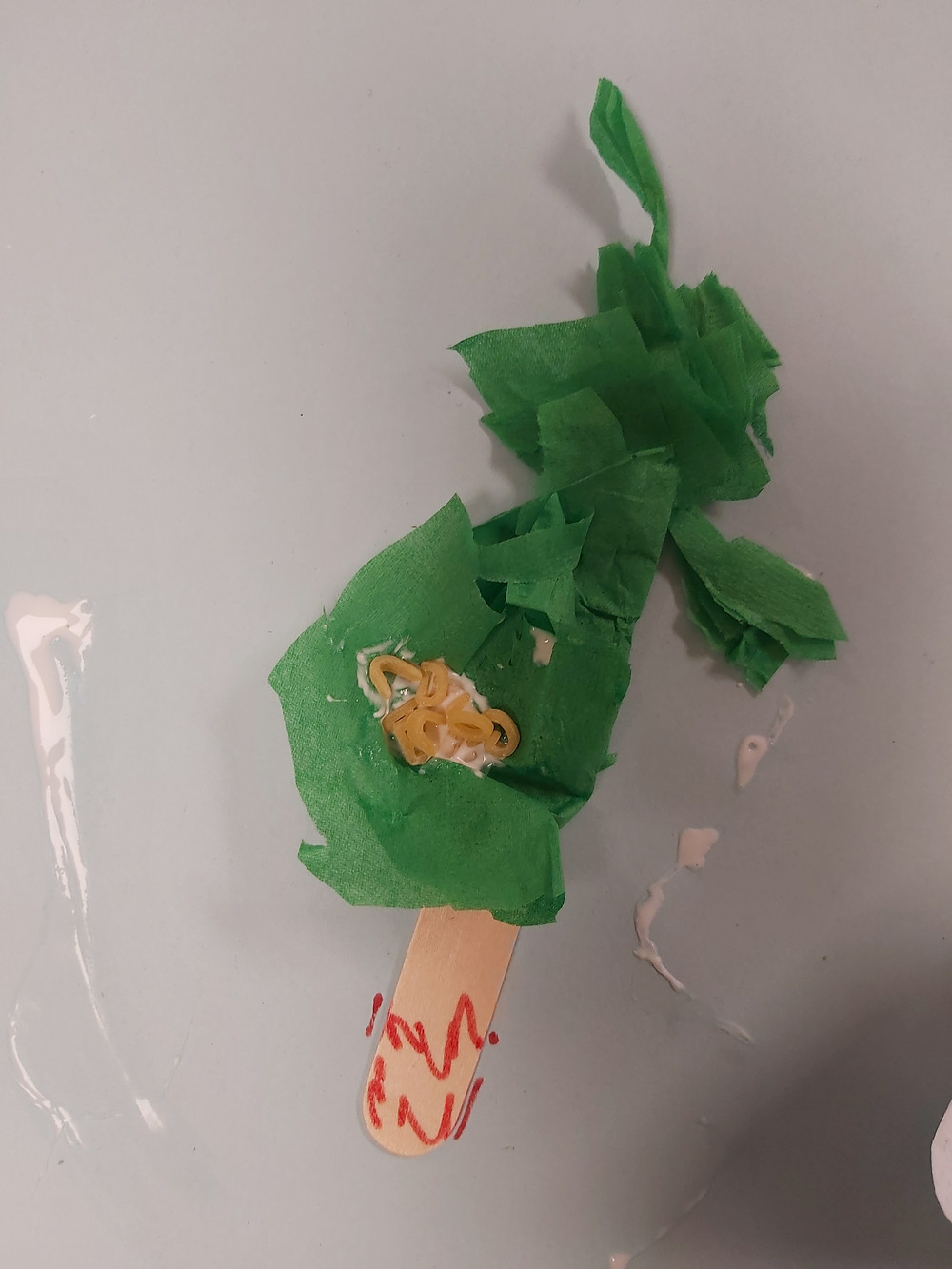 preschooler's coconut tree craft with alphabet pasta