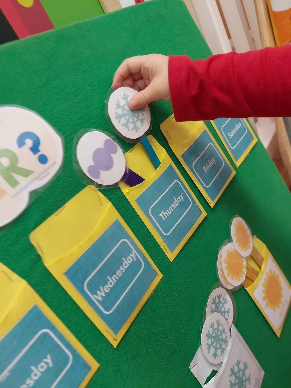 preschooler exploring weather Touch and Play display