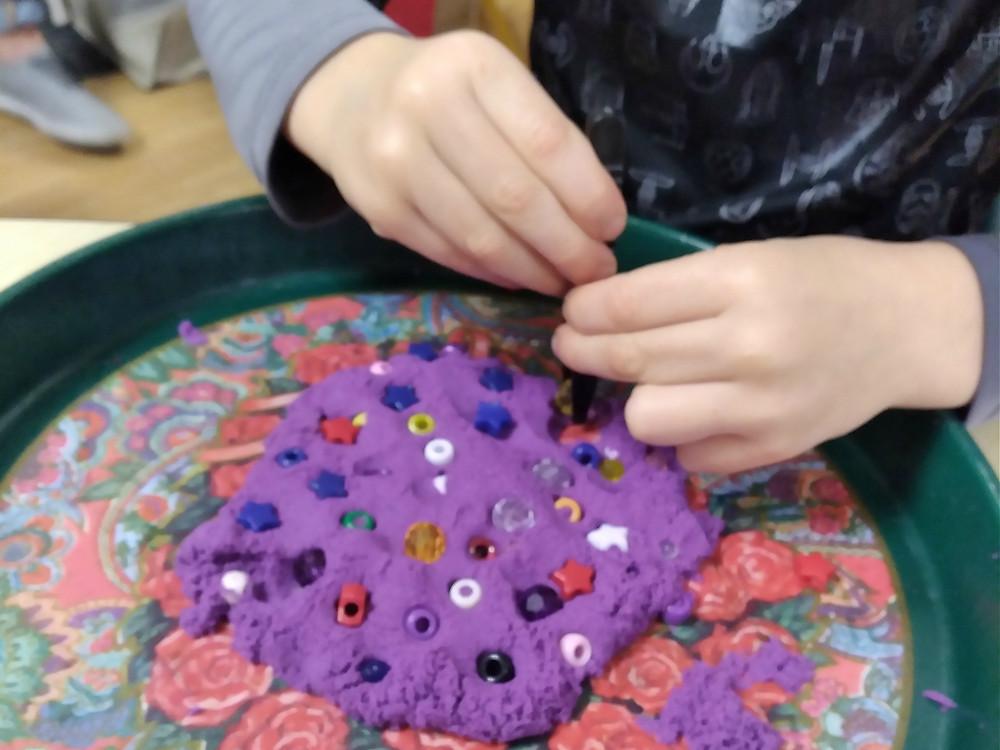 beads stuck into playdough