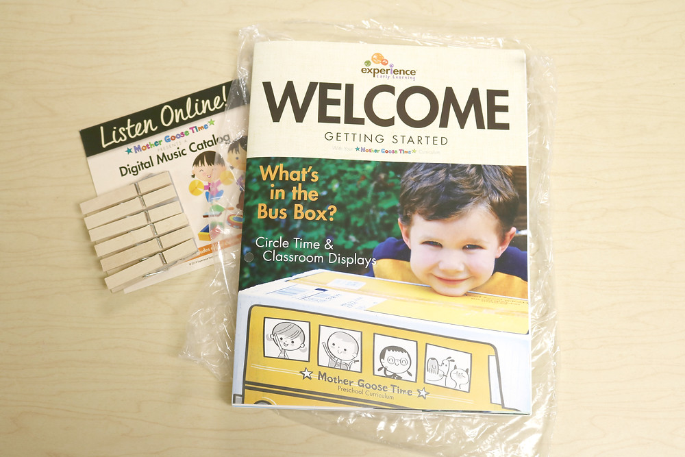 welcome guide, digital music catalog, and pack of clothespins