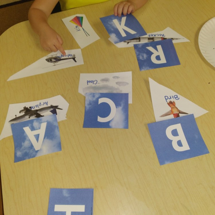 preschooler doing flying objects literacy activity